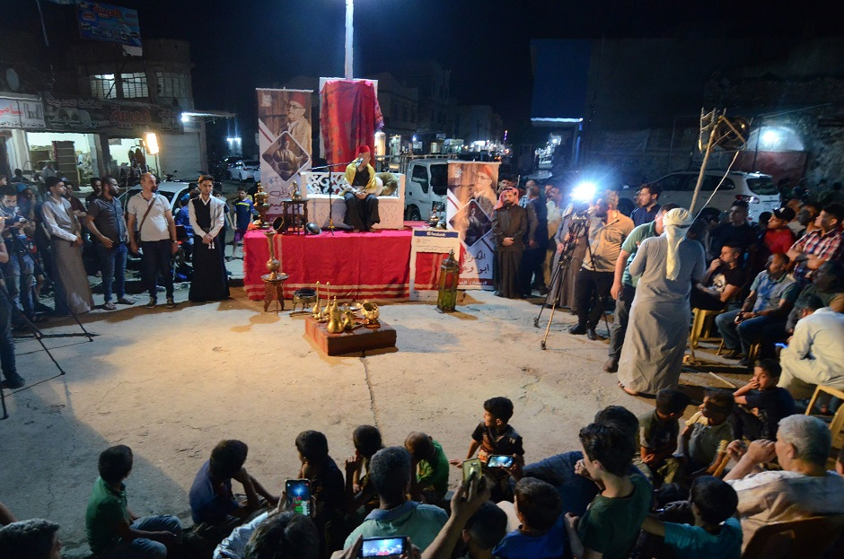 Traditional storyteller Abdel Wahed Ismail (R), entertains an audience in the northern Iraqi city of Mosul. PHOTO: AFP