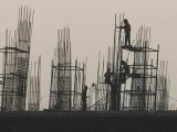labourers-work-at-the-site-of-a-commercial-building-under-construction-in-noida-2-2