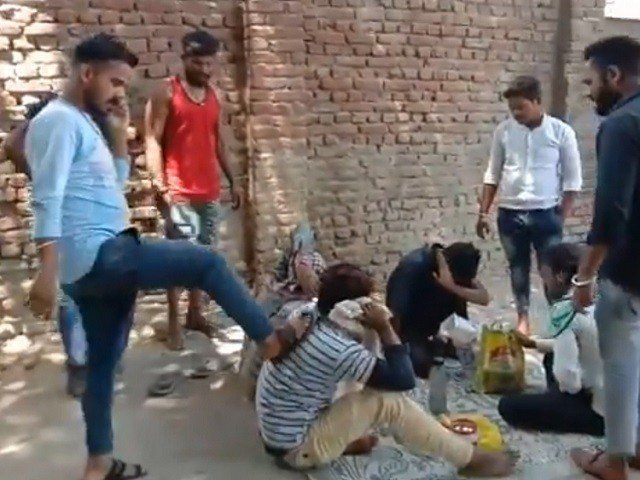 Viral video showed a group of men abusing the four labourers, thrashing them with belts. SCREENGRAB: TWITTER:@ RADIOPAKISTAN