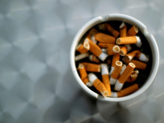 A Reuters file photo showing ash tray with cigarette butts.