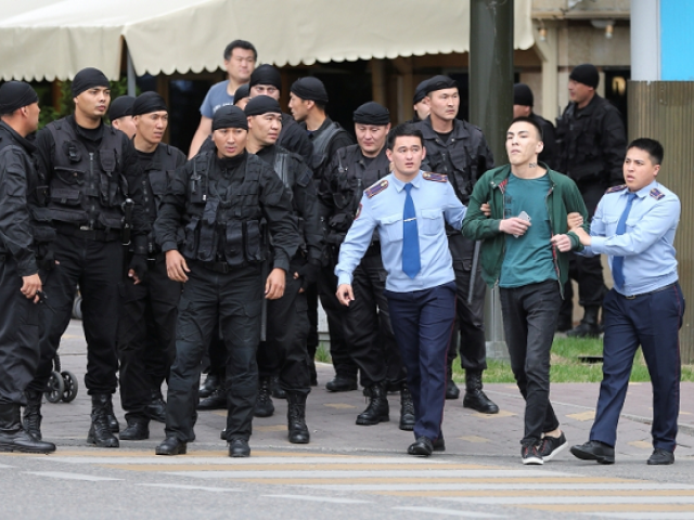 Law enforcement officers detain a man during an opposition rally held by critics of Kazakh President Kassym-Jomart Tokayev, who protest over his election in Almaty, Kazakhstan June 12, 2019. PHOTO: REUTERS