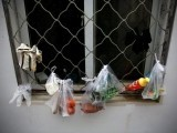 file-photo-groceries-in-plastic-bags-hang-by-a-window-in-beijing-2-2