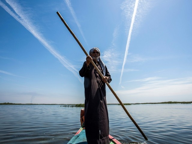 1.	Abu Hayder, an Iraqi ecotourism guide, navigates a canoe in the marshes of the southern district of Chibayish in Dhi Qar province, about 120 kilometres northwest of the southern city of Basra. PHOTO: AFP