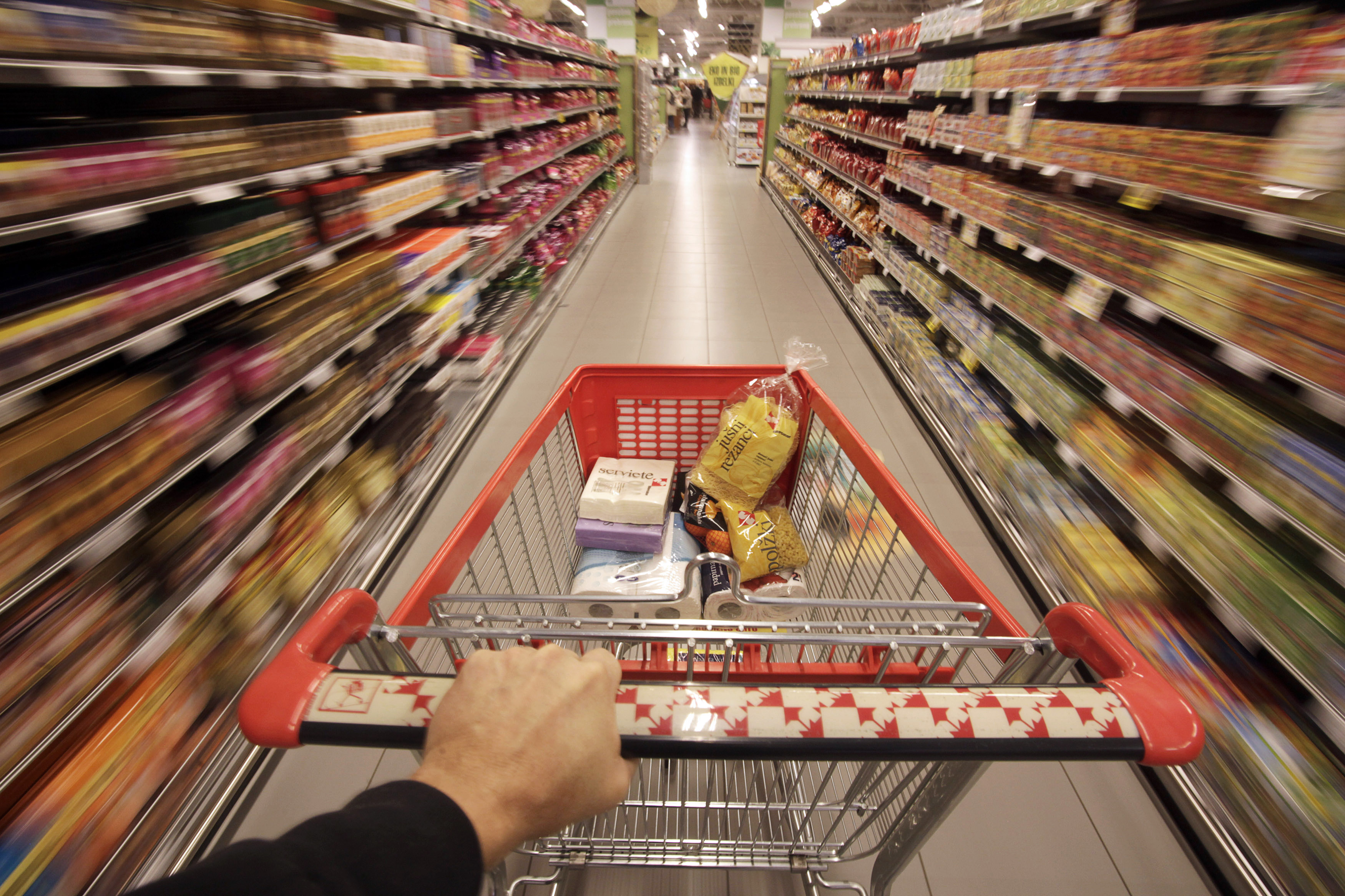 A shopping cart is pushed down the aisle in this REUTERS photo illustration.