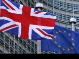 a-union-jack-flag-flutters-next-to-european-union-flags-ahead-of-a-visit-from-britains-pm-cameron-at-the-eu-commission-headquarters-in-brussels-2