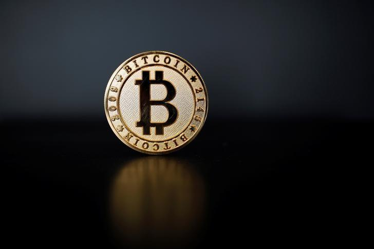 Coin sales have already eclipsed funds blockchain firms received from venture capital. PHOTO: REUTERS