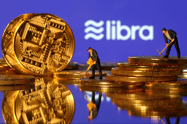 Small toy figures are seen on representations of virtual currency in front of the Libra logo in this illustration picture, June 21, 2019. PHOTO: REUTERS