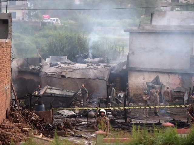 Soldiers cordon off the site where a Pakistani Army Aviation Corps aircraft crashed in Rawalpindi. -AFP