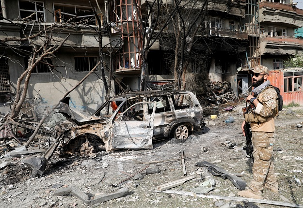 An Afghan security force personnel inspects the site of Sunday's attack in Kabul. PHOTO: REUTERS