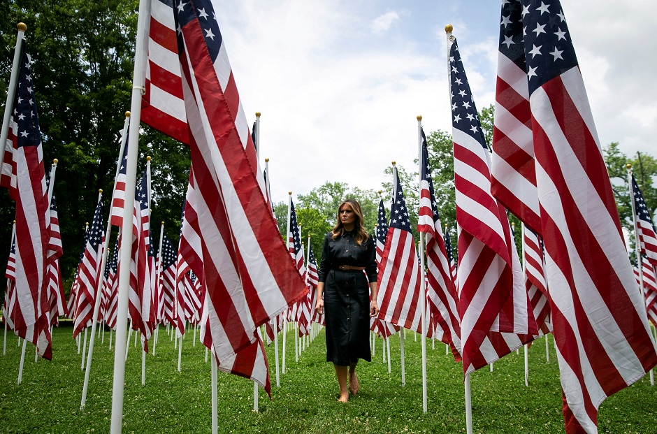 US first lady Melania Trump visits a field of American flags. REUTERS