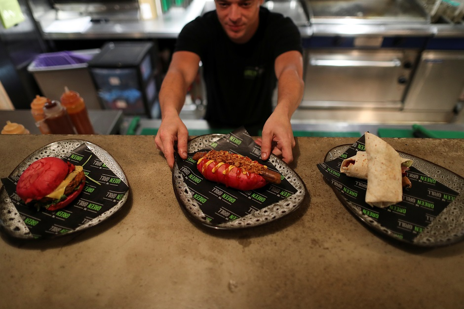 base, in Hong Kong, China A chef serves up vegan food in the Green Grill section of the Green Vic, which is aiming to be the world's most ethical pub, in Shoreditch, London, Britain:REUTERS