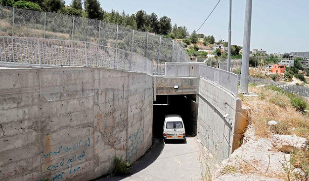 A picture taken on May 30, 2019, shows Hajajla family's car passing through the tunnel connecting their home in Jerusalem to al-Walajah, their village in the occupied West Bank, on May 30, 2019. PHOTO: AFP