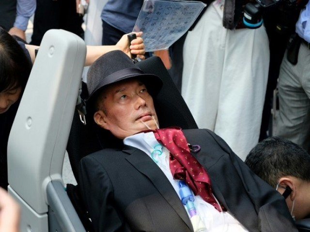 Japanese lawmaker Yasuhiko Funago's election has highlighted the fact Japan only pays for care if the disabled person is not working. PHOTO: AFP