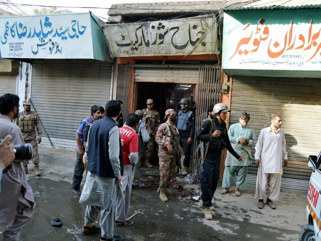 One martyred and 13 injured as IED exploded inside the market on Mission Road. PHOTO: PPI