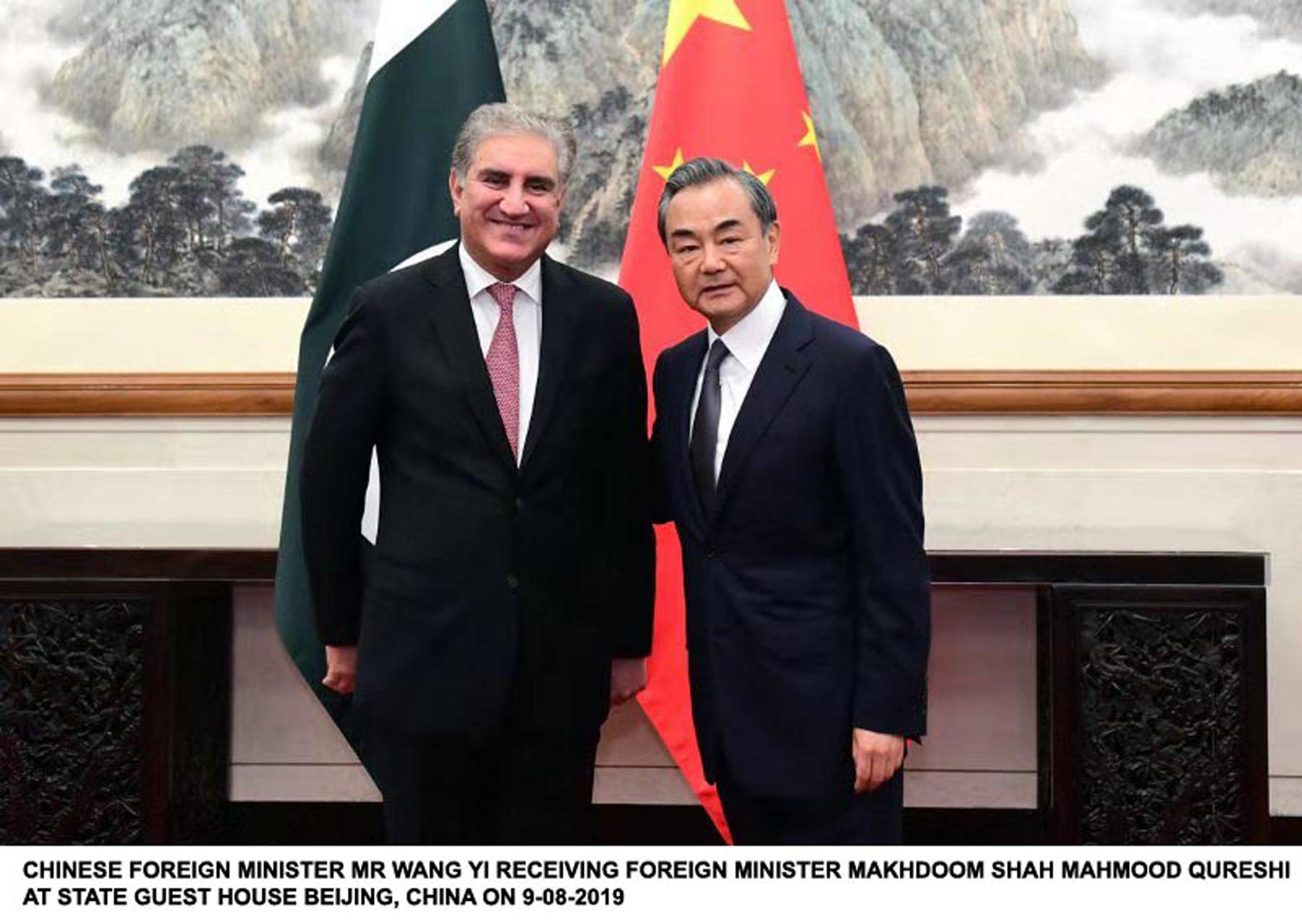 Foreign Minister Shah Mehmood Qureshi with Chinese counterpart Wangu Yi in Beijing on Friday. PHOTO: PID