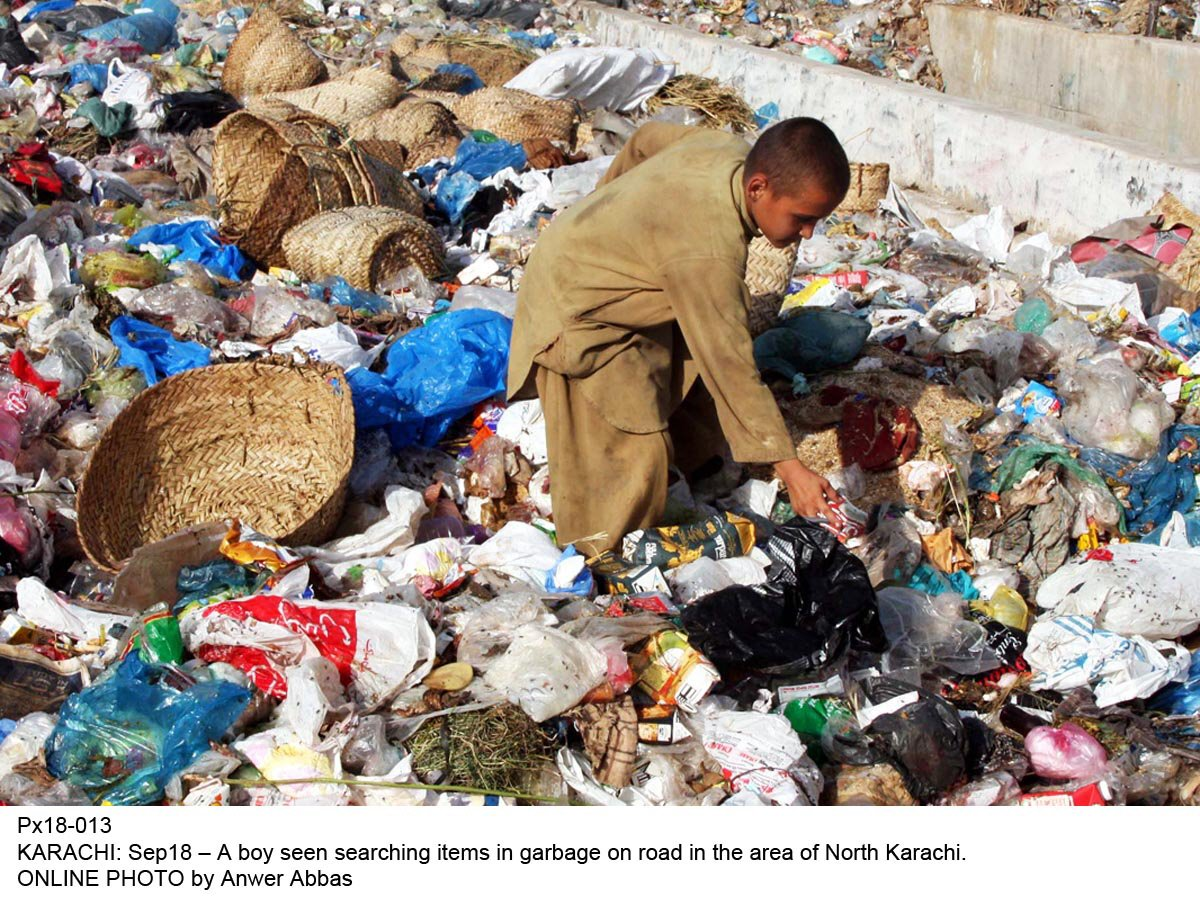 A young boy collecting garbage. PHOTO: ONLINE