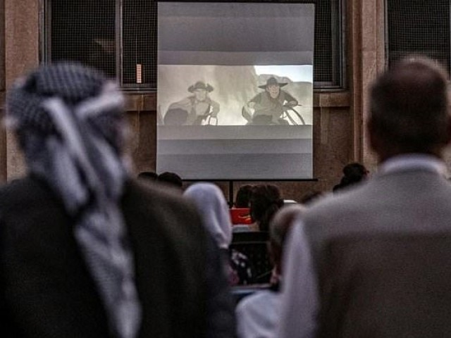 Not having been to the cinema in decades, even some of the older men in the village come to see the cartoon being screened. PHOTO: AFP.
