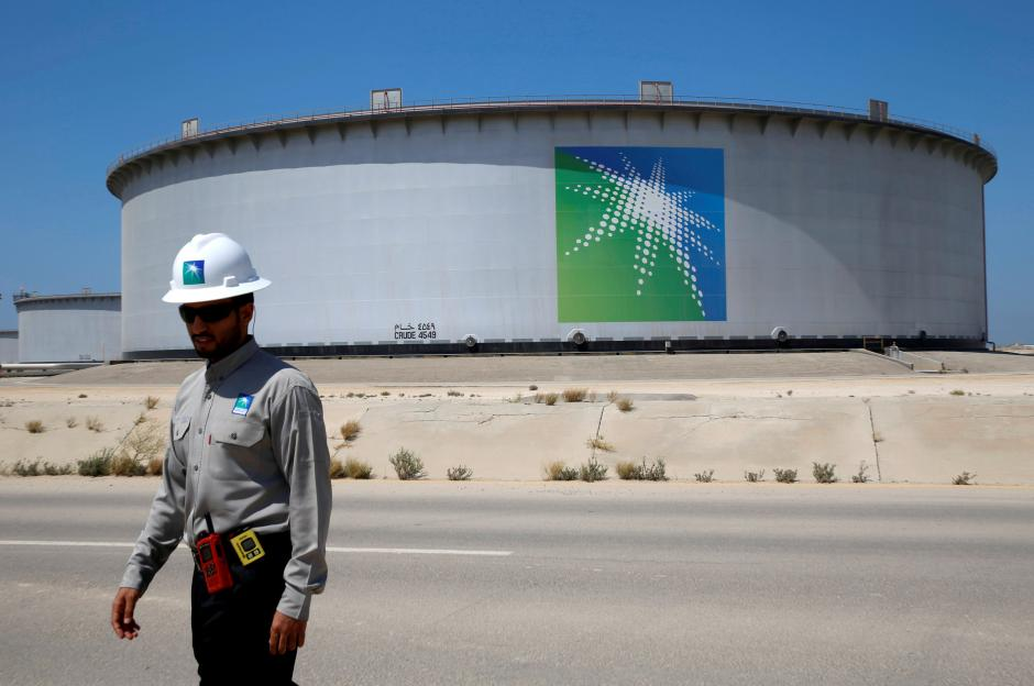 file-photo-an-aramco-employee-walks-near-an-oil-tank-at-saudi-aramcos-ras-tanura-oil-refinery-and-oil-terminal-2-2
