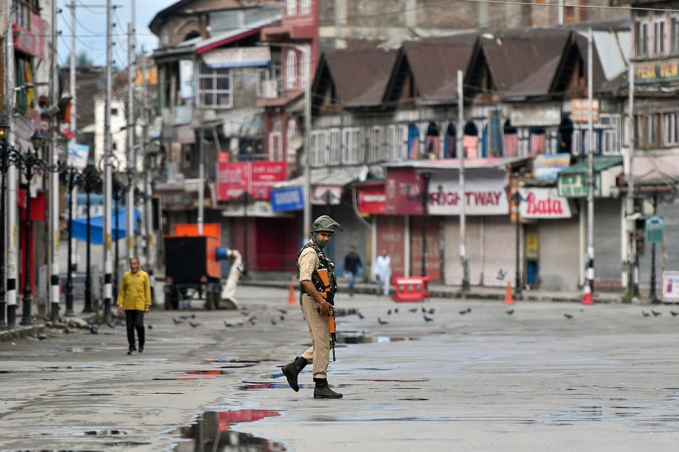 In this file photo taken on August 19, 2019, an occupying force personnel patrols on a deserted road of the Lal Chowk area in Srinagar.  PHOTO: AFP