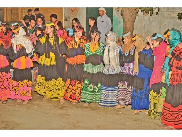 Kalash women, decked in their traditional attire, dance during the Uchau festival. PHOTO: EXPRESS