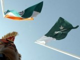 an-indian-border-guard-stands-near-indian-and-pakistani-flags-during-a-fair-in-chamliyal-in-the-northern-indian-state-of-jammu-and-kashmir-2