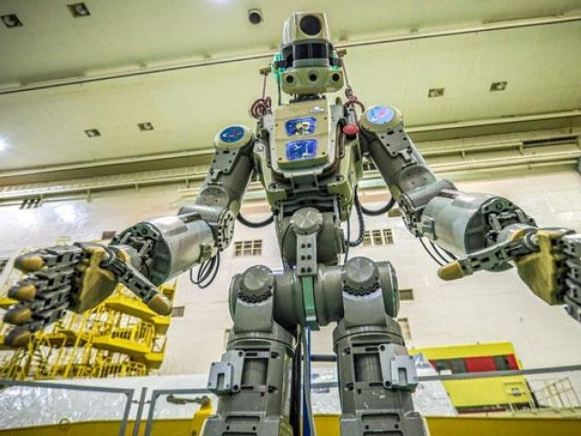 This handout photo taken on July 26 and released by the official website of the Russian State Space Corporation ROSCOSMOS on August 21 shows Russian humanoid robot Skybot F-850 (Fedor) being tested ahead of its flight on board Soyuz MS-14 spacecraft at the Baikonur Cosmodrome in Kazakhstan. PHOTO: AFP