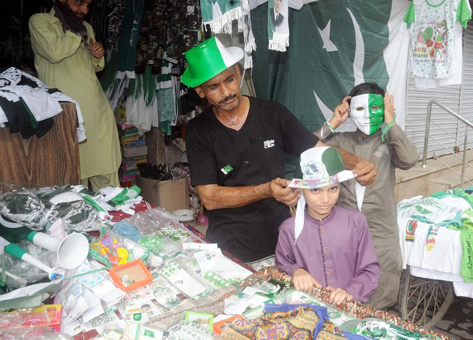 People gear up for Independence Day in Hyderabad, also the third day of Eidul Azha. PHOTO: APP