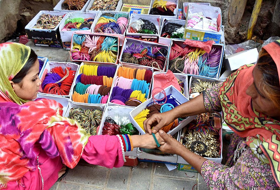 A young girl shopping for Eid festivities at Resham Gali. PHOTO: APP