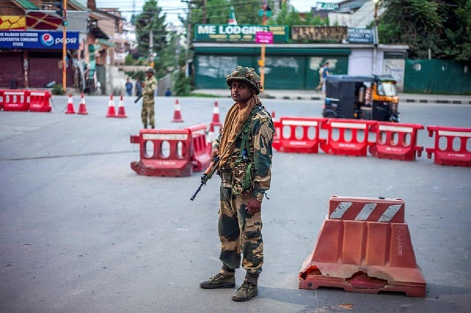 Security personnel stand guard on a street in Srinagar. PHOTO: AFP