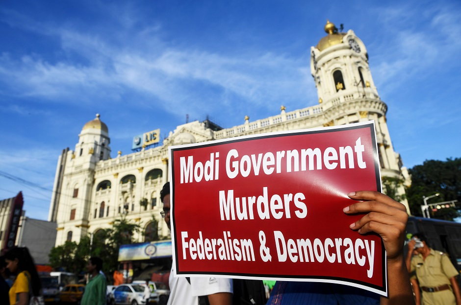 Protestors and social activists take part in a protest in Kolkata on August 6, 2019, in reaction to the Indian government scrapping Article 370 that granted a special status to Jammu and Kashmir. PHOTO: AFP