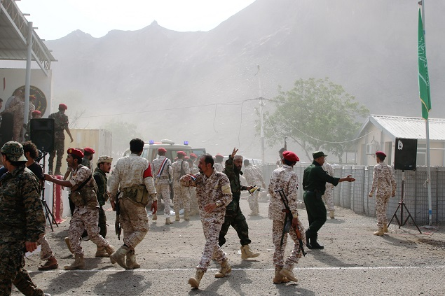 Soldiers rush to help the injured following a missile attack on a military parade during a graduation ceremony for newly recruited troopers in Aden, Yemen. PHOTO: REUTERS