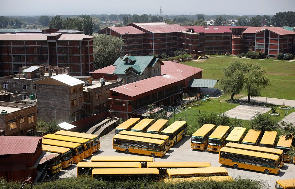 Buses are seen parked at a closed school area in Indian Occupied Kashmir. (PHOTO: REUTERS)