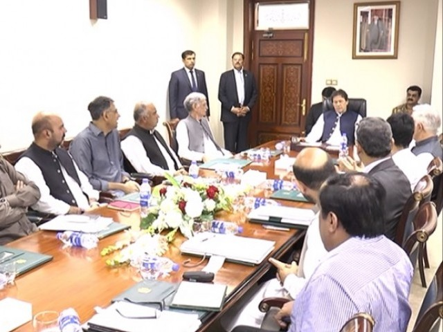 PM Imran Khan chairs meeting attened by K-P Chief Minister Mehmood Khan, K-P Governor Shah Farman, Defence Minister Pervez Khattak, senior PTI leader Asad Umar and other top officials. PHOTO: PID