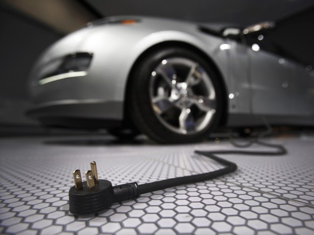 A plug is seen coming from an electric car during the North American International Auto Show in Detroit, Michigan. PHOTO: REUTERS