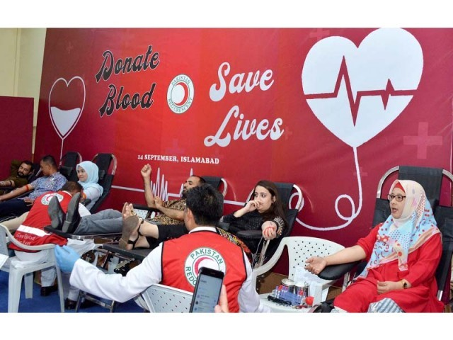 People donate blood at the Indonesian Embassy. PHOTO: EXPRESS