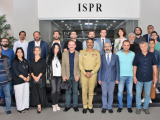 DG ISPR Maj Gen Asif Ghafoor with a group of Turkish journalists at the military media wing's headquarters in Rawalpindi on September 16. PHOTO: ISPR