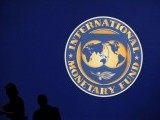 visitors-are-silhouetted-against-the-logo-of-the-international-monetary-fund-imf-in-tokyo-4-3-2-2-2-3-2-3-2-2-2-2-2-2-2-2-2-2-2-2-2-2