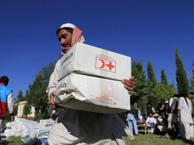 An Afghan man receives aid from the International Federation of the Red Cross and Red Crescent Societies after an earthquake, in Behsud district of Jalalabad province, Afghanistan. PHOTO: REUTERS