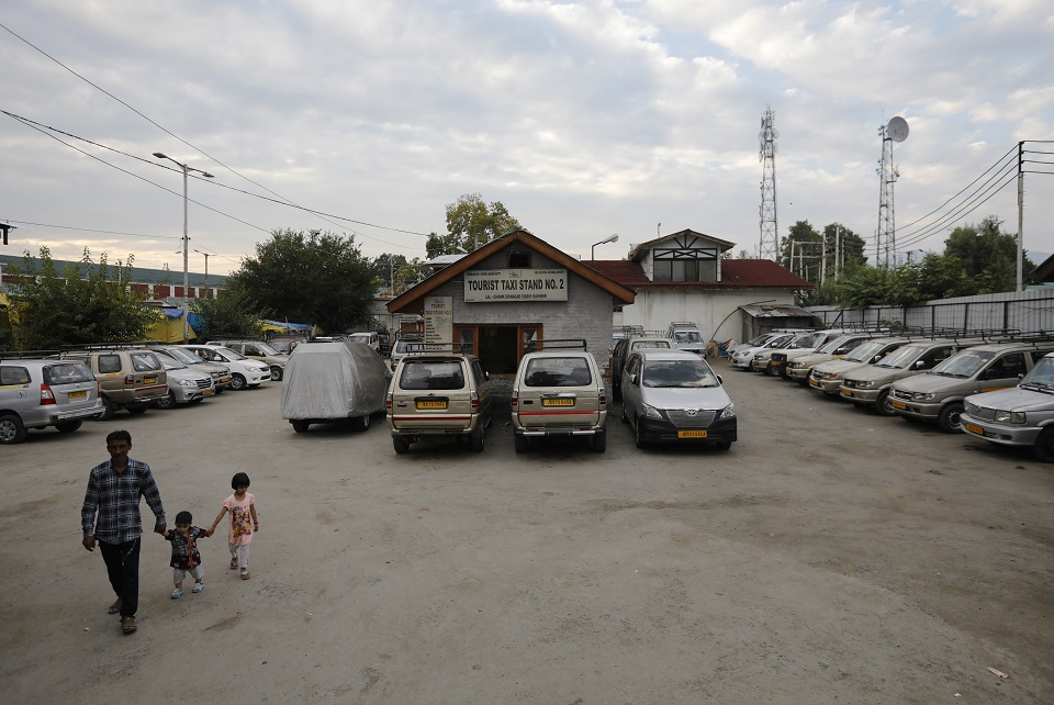 Tourist taxis are seen parked at a stand during Kashmir lockdown. (PHOTO: REUTERS)