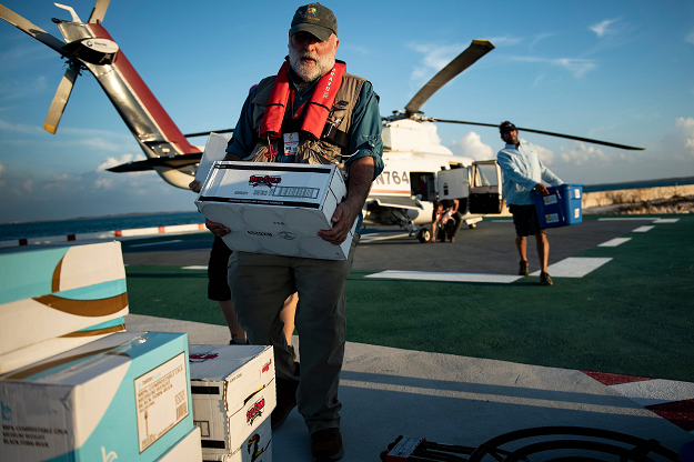 Chef Jose Andres carries food relief while working with his charity group World Central Kitchen to help survivors of Hurricane Dorian September 5, 2019, in Marsh Harbor, Great Abaco, Bahamas. PHOTO: AFP