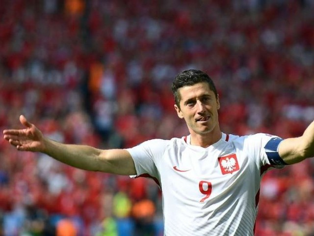 Lewandowski's side remain three points clear of Austria, who won 1-0 in Slovenia, at the top of Group G. PHOTO: AFP