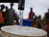 children-watch-as-women-pump-water-from-a-borehole-near-malawis-capital-lilongwe-2-2-2-2-2-2-2-2-2-2