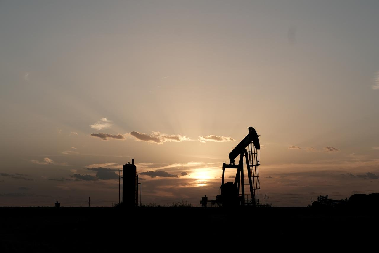 Oil ticks up as rising crude stocks offset by product demand
