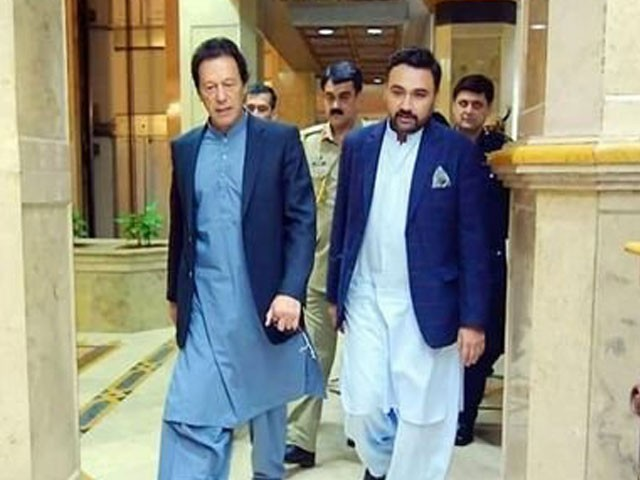 Babar bin Atta with Prime Minister Imran Khan. PHOTO: TWITTER