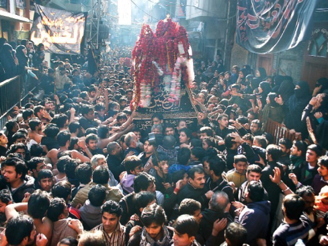 File photo of mourners carrying the taziya on Hazrat Imam Hussain's (RA) chehlum. PHOTO: ABID NAWAZ/EXPRESS