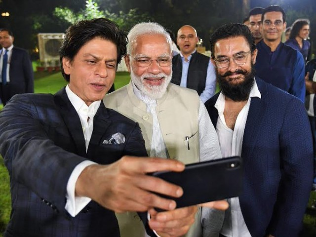 Shah Rukh Khan, Aamir Khan slammed for posting pictures with PM Modi