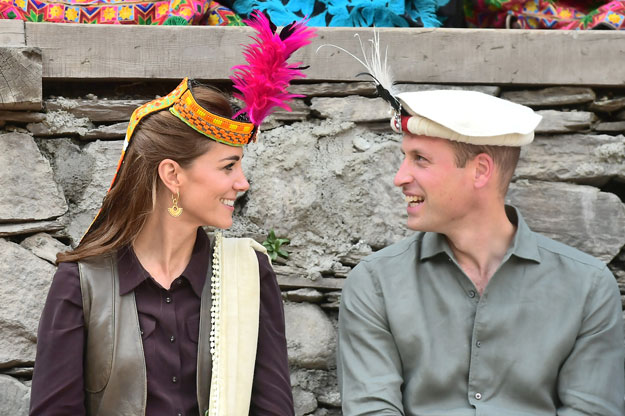 Britain's Prince William and Catherine, Duchess of Cambridge look at each other while visiting a settlement of the Kalash people in Chitral on Wednesday. PHOTO: REUTERS