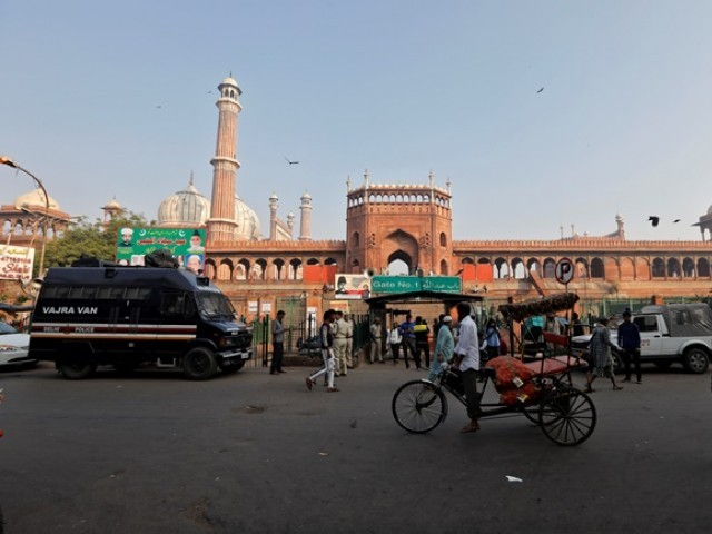 Policemen stand guard at a gate of Jama Masjid, before Supreme Court's verdict on a disputed religious site claimed by both majority Hindus and Muslim in Ayodhya. PHOTO: REUTERS
