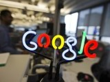 A neon Google logo is seen as employees work at the new Google office in Toronto, November 13, 2012.    PHOTO: REUTERS