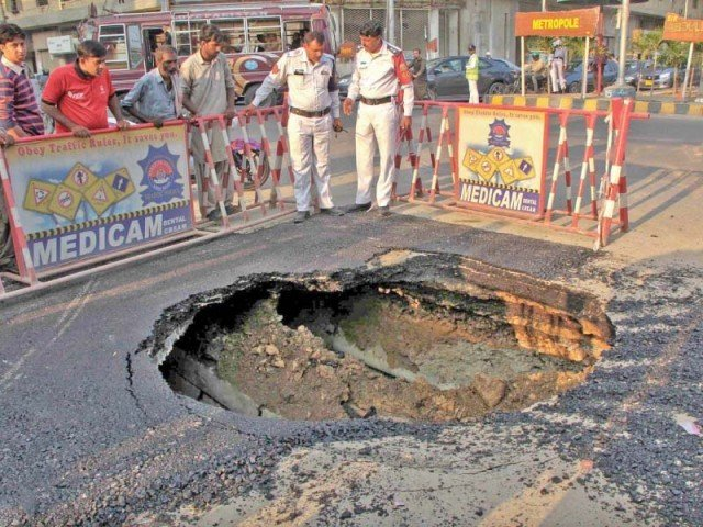 Despite KWSB's tall claims, Club Road caved in within days of being repaired after it caved in on November 4. PHOTO: INP